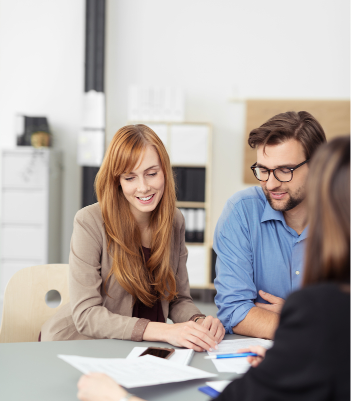 couple meeting with real estate lawyer